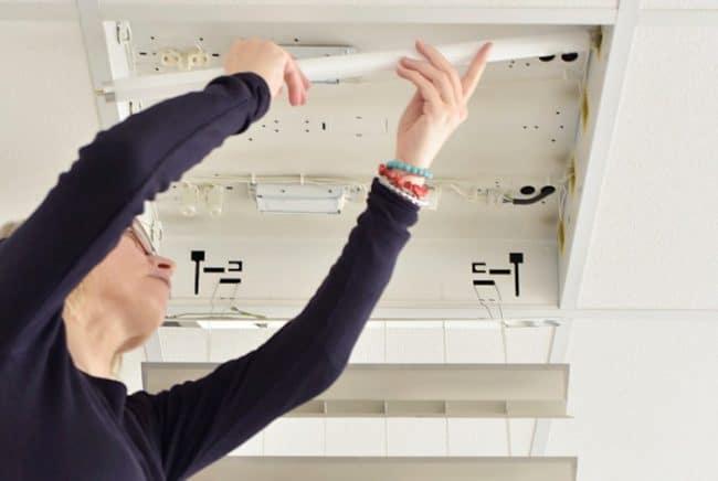 installing new light bulb into fixture