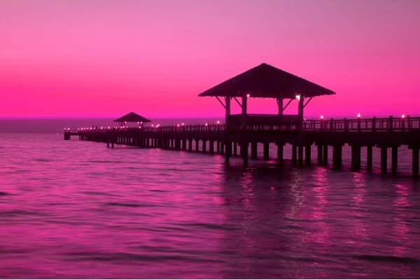 pop art style silhouette of wooden pavilion on the pier at sunset