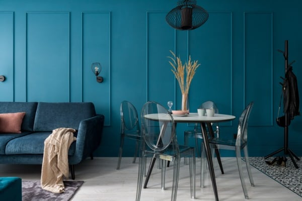 small room with stylish blue wall