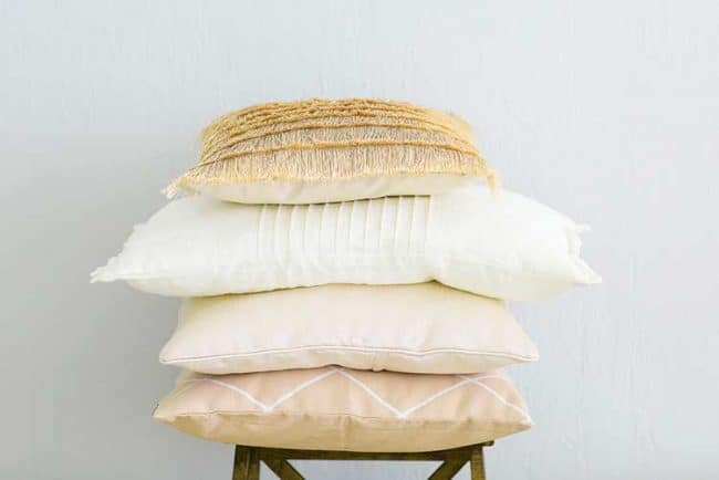 stack of peach colored pillows